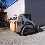Bobcat T190 with bucket, forks, broom, profiler, level bar & auger