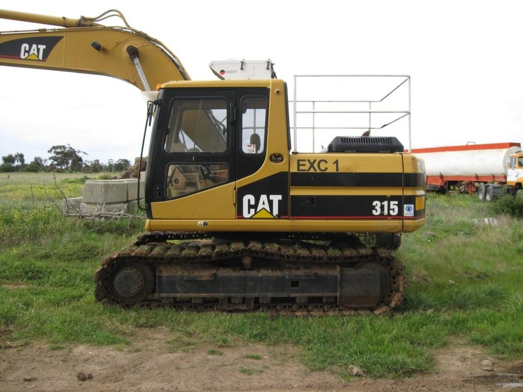 Caterpillar 315 Tracked Excavator fitted with rubber cleats and an Engcon Rotating Hitch